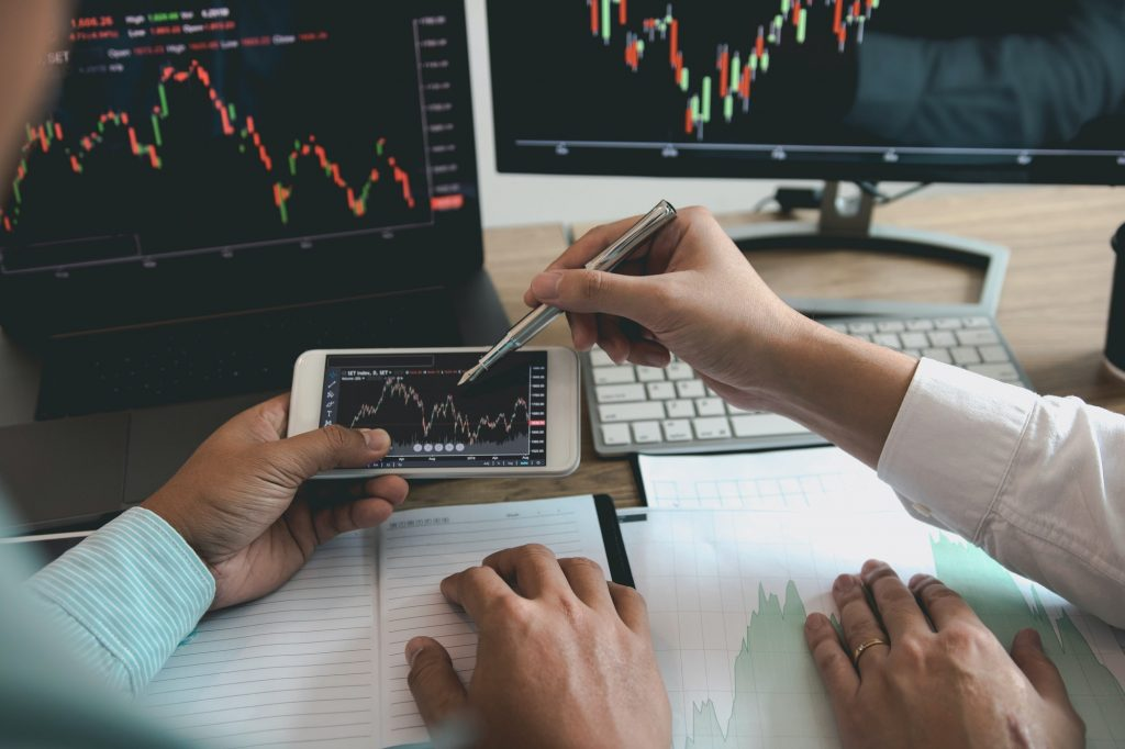 investors are working together to analyze the graph of the company shares